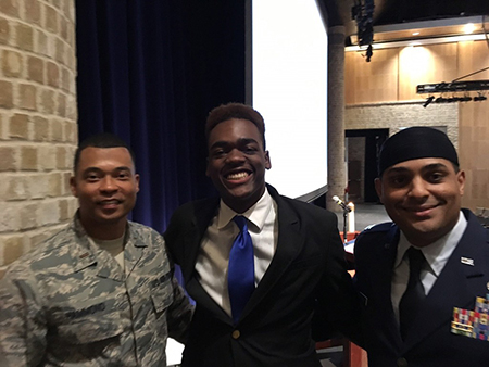 senior student posing with air force chaplain and iman